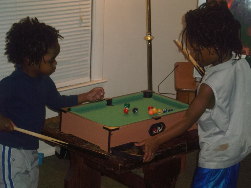 Hubby shows our kids how to play pool, his favorite past time!
