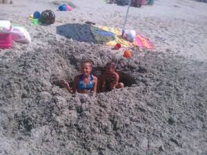 These girls were digging a tunnel to the Pavilion on Myrtle Beach... Just kidding.