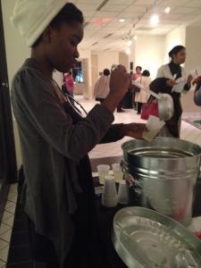 Cassie's using a soup ladle!