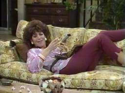 "Margaret ""Peggy"" Bundy, played by Katey Sagal, is Al's wife and very lazy. She refuses to cook for the family or to clean the house. She also prefers shopping new clothes to washing them and doesn't even think of having a job. During the day she likes to watch all the day time talkshows, sitting on the beloved family couch and eating tons of bonbons (without getting fat, though). Her favourite TV show is ""Oprah"", but she also likes the Home Shopping Network. Peggy usually wears white trash fashion with tight pants and stilettos."