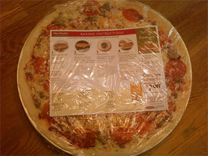 This is how the pizza is sold after you order it. Instructions and all.