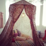 Cozy reading fort, made with a hoop.
