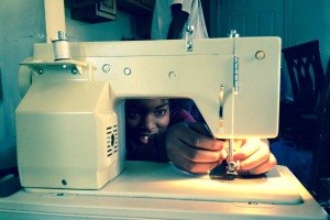 my daughter sewing - self sufficiency
